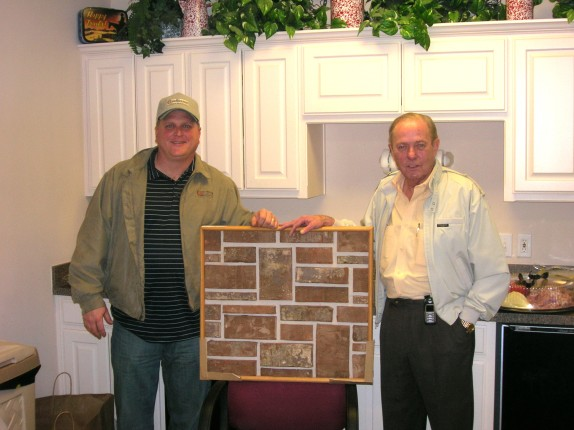 Wilson Thomas (right) shows Todd Carmichael of Packer Brick the latest in brick innovation--Claystone!